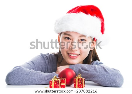 Young happy woman smile with Christmas hat and grey sweater isolated on white.