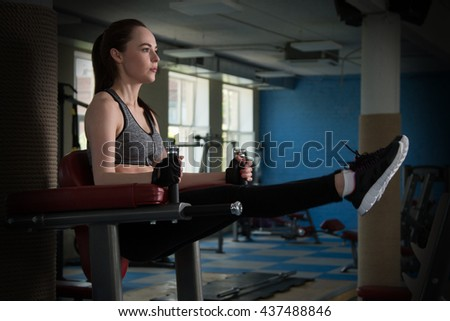 Young happy woman training in the gym - stock photo