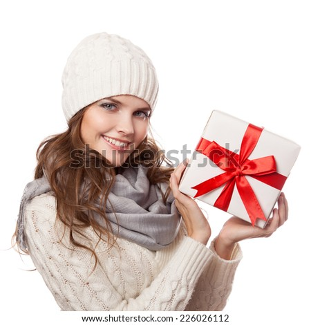Young happy woman with a gift. Christmas. Isolated. - stock photo