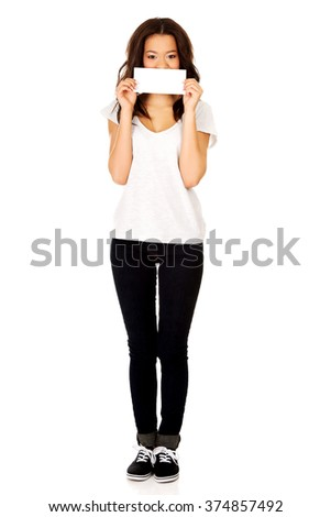 Young happy woman with blank paper. - stock photo