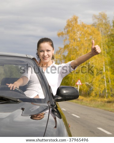 young happy woman with her new car