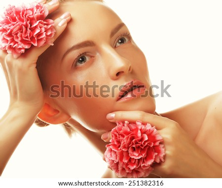 young happy woman with pink flowers, isolated on white - stock photo