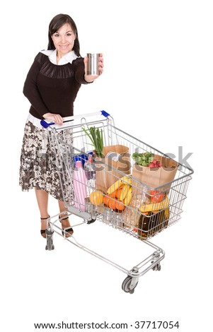 young happy woman with shopping cart. over white background - stock photo