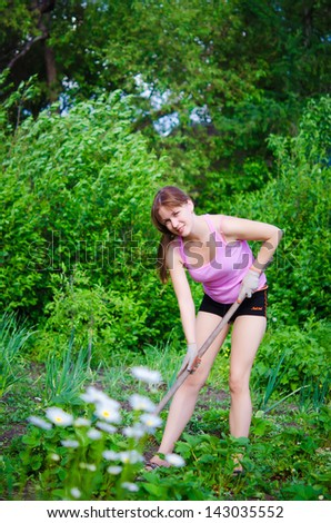 young happy woman working in the garden