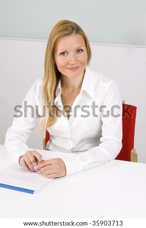 young happy woman writing notes