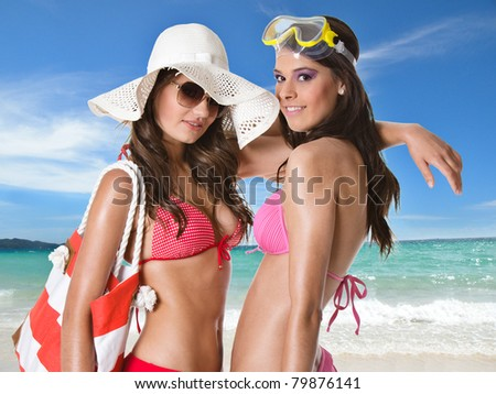 Young happy women at the beach - stock photo