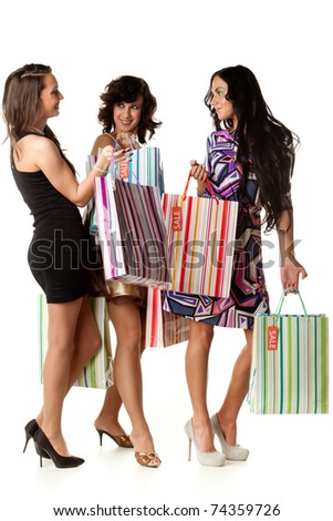 Young happy women with shopping bags  on a white background. Sale. - stock photo