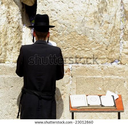 young hasidic jew at the wailing western wall, jerusalem, israel - stock photo