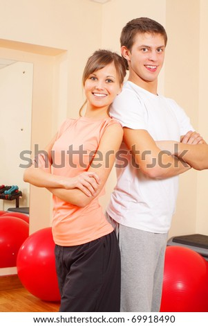 Young health couple at the gym