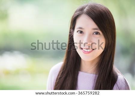 young health woman smile to you. nature green background, asian beauty - stock photo