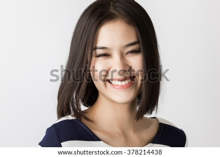 Young healthy asian short hair woman stock photo 378214438 young healthy asian short hair woman with smiley face urmus Images