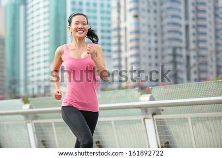 young healthy asian woman running at city  - stock photo