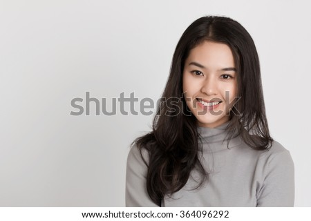 Young healthy Asian woman with smiley face. - stock photo