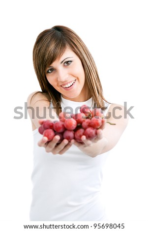 Young healthy attractive woman holding red grapes.Isolated
