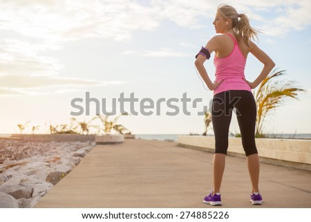 Young healthy fit woman ready for fitness exercise outdoors - stock photo