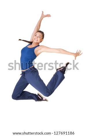 Young healthy fitness woman jump isolated on white background - stock photo