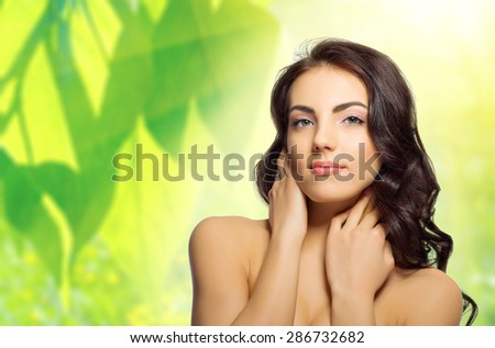 Young healthy girl at floral background