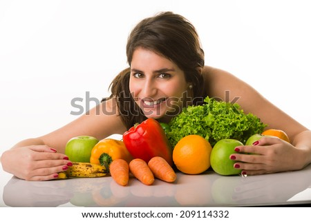 Young healthy girl holding her vegetables