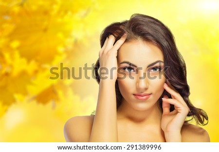 Young healthy girl on autumn background - stock photo
