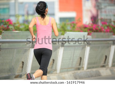 young healthy lifestyle asian woman running at modern city