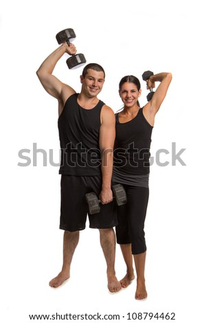 Young Healthy Looking Couple Lifting Weights Isolated on White