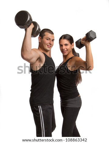 Young Healthy Looking Couple Lifting Weights Isolated on White - stock photo