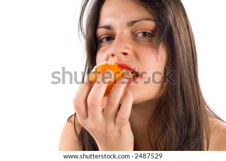Young healthy woman eating fresh orange, isolated on white