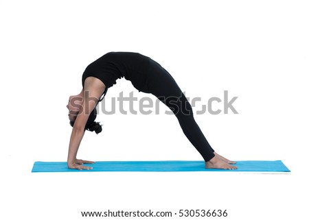 Young healthy woman practicing Bridge pose yoga on white background.