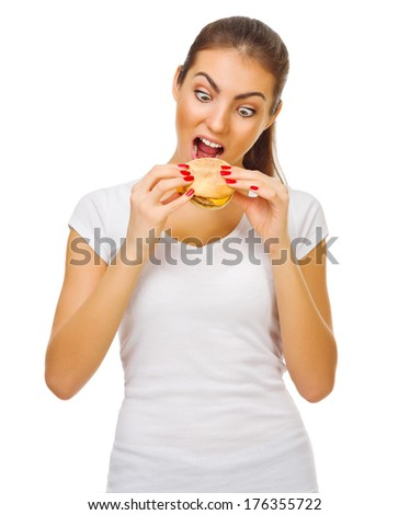 Young healthy woman with hamburger isolated - stock photo
