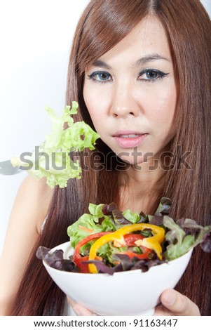 Young  healthy woman with her vegetable salad - stock photo