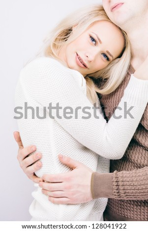 Young heterosexual couple in casual clothes - stock photo