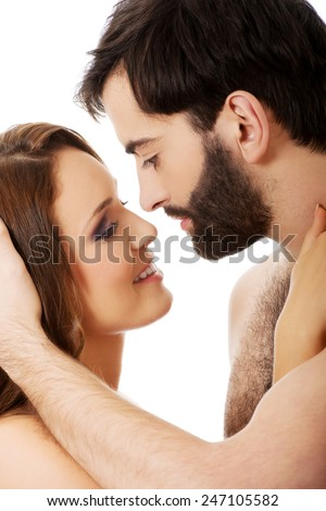 Young heterosexual couple pretending to kiss each other. - stock photo