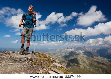 Young hiker enjoying mountain trekking - stock photo