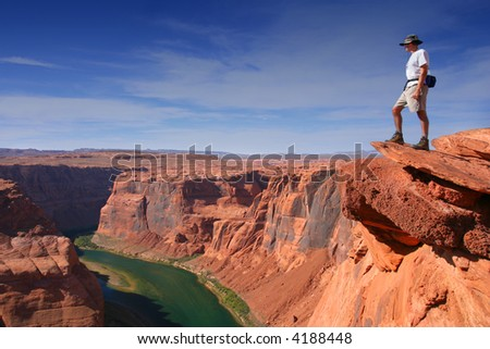 Young Hiker overlooking Grand Canyon - stock photo