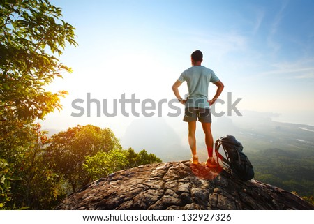 Young hiker relaxing on top of a mountain - stock photo