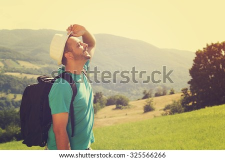 Young hiker with backpack. - stock photo
