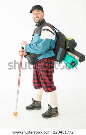 Young hiker with backpack and boots isolated - stock photo