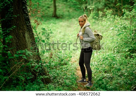 Young hiker woman with backpack - stock photo