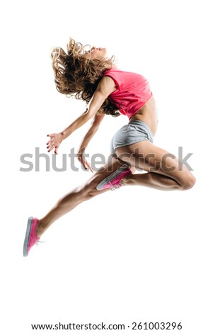 young hip-hop dancer posing in studio - stock photo