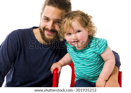 Young hip man with a beard playing with his sweet little 16 months old daughter, isolated against white background. - stock photo