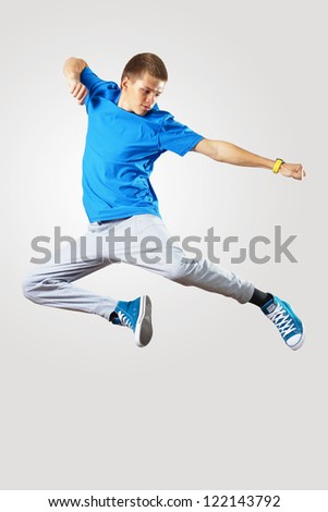 Young hiphop dancer making a move on white - stock photo
