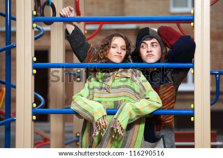 Young hippie couple on the playground