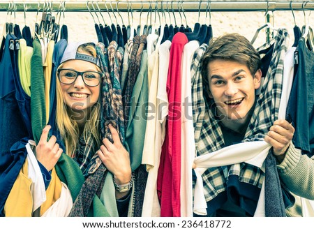 Young hipster couple in love at the weekly flea market - Best friends sharing free time having fun and shopping in the old town - Lovers enjoying everyday life moments on a vintage filtered look - stock photo