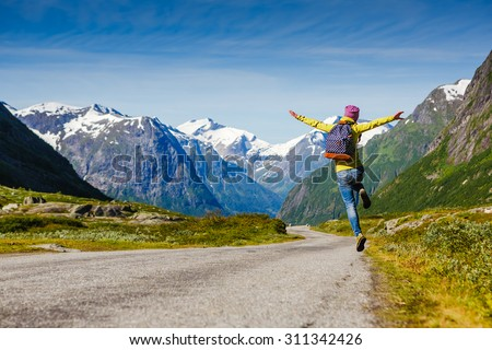 young hipster female traveler enjoy the travel. Adventure is coming... - stock photo