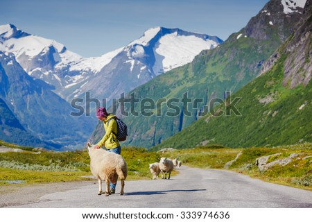 young hipster female traveler enjoy the travel. Norway - stock photo