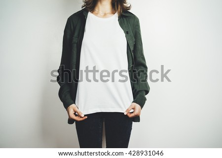 Young hipster girl wearing blank white t-shirt, mock-up of template white t-shirt in the white background - stock photo