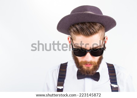 young hipster man wearing  hat and bow-tie  - stock photo