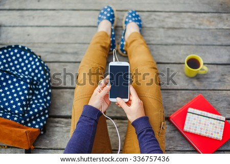 young hipster woman using smart phone outdoor - stock photo