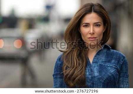 Young Hispanic caucasian woman serious face portrait - stock photo