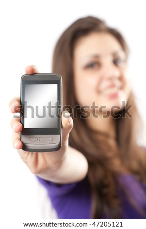 Young hispanic girl holding a mobile phone or PDA to the viewer - stock photo